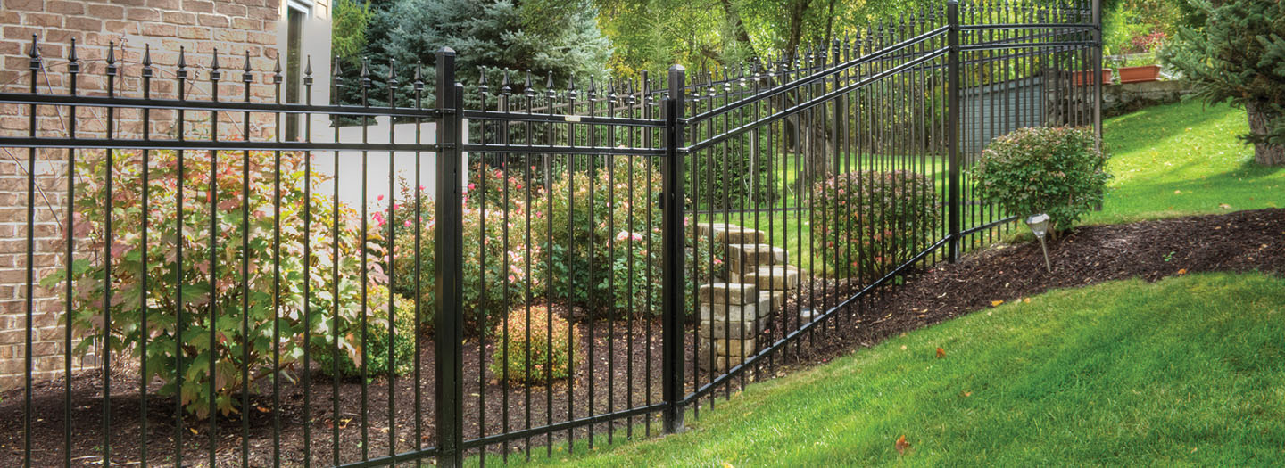 black metal ornamental fence around yard