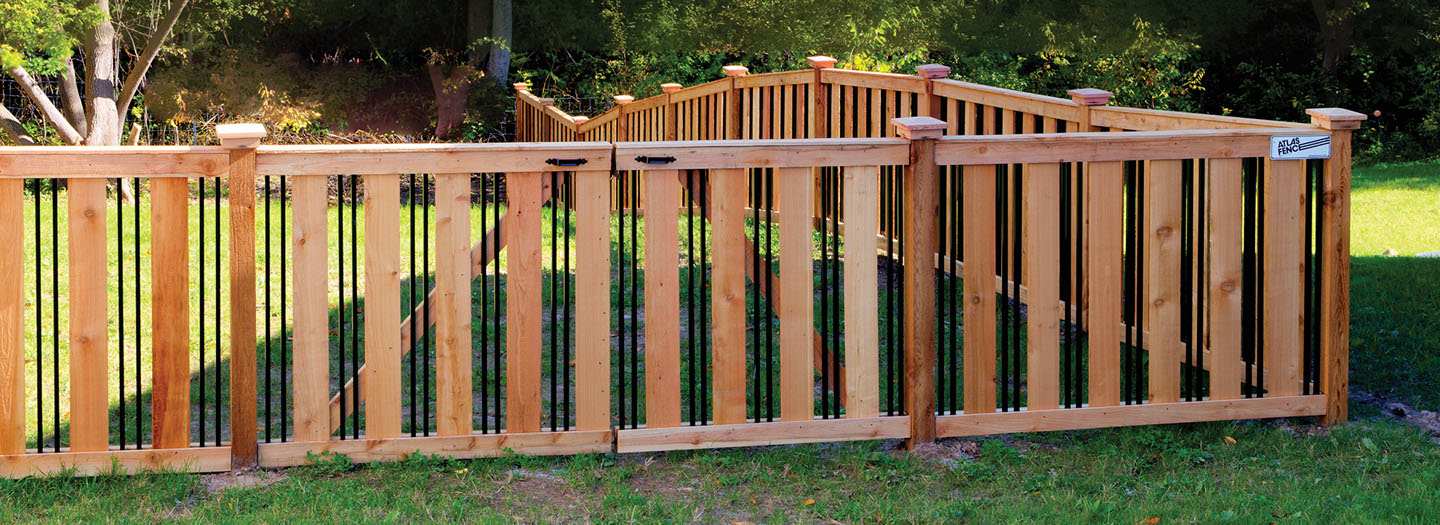 ornamental custom craftsman fence with gate in backyard