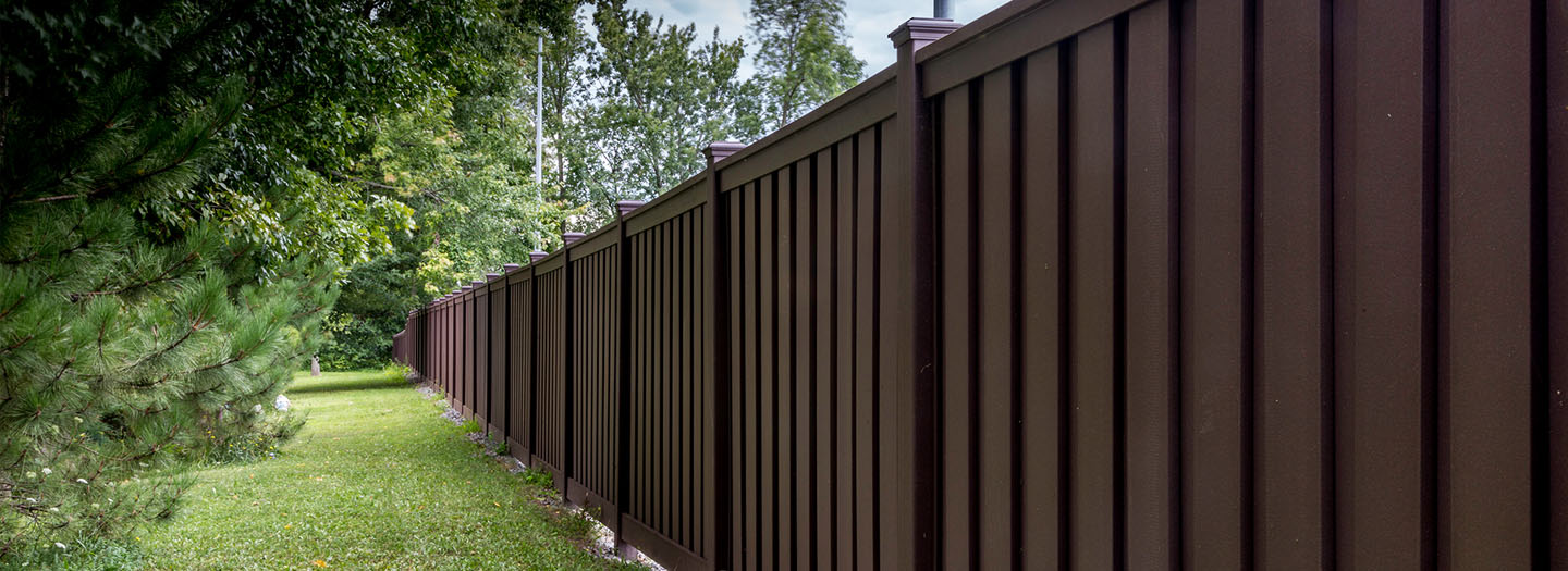 dark brown wood fence around property