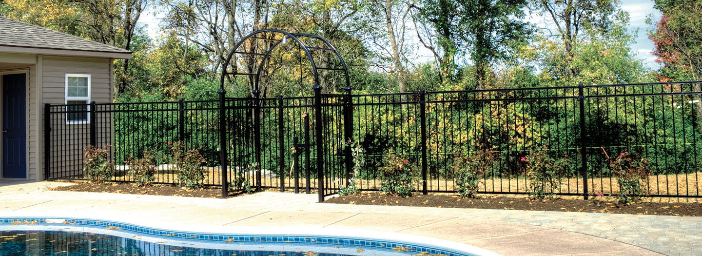 ornamental black fence around pool