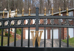 residential estate gate with gold accents
