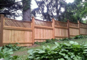 residential courtyard wood fence on a grade